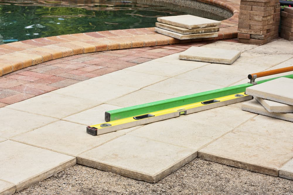 repairing the pavers around the pool area
